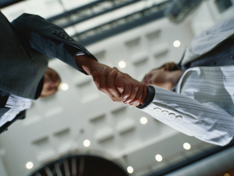 Businesspeople Shaking Hands, Low Angle View